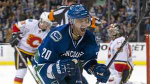 Chris Higgins of the Vancouver Canucks celebrates after scoring during the second period against the Calgary Flames on Dec. 4, 2011.