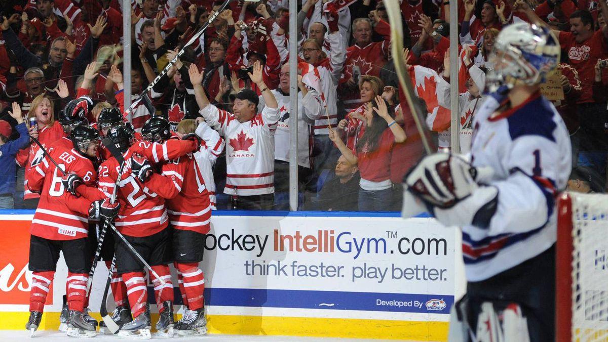 Team Canada celebrates Ryan Johansen's second period goal as Team United States goaltender Jack Campbell looks on.