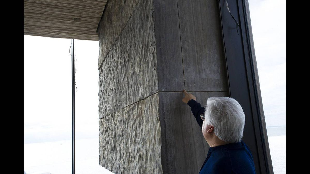 Former RIM co-CEO Mike Lazaridis' points at slabs of stone taken from the bed of Lake Huron at his property located near Amberley, ON. Feb. 1, 2012.
