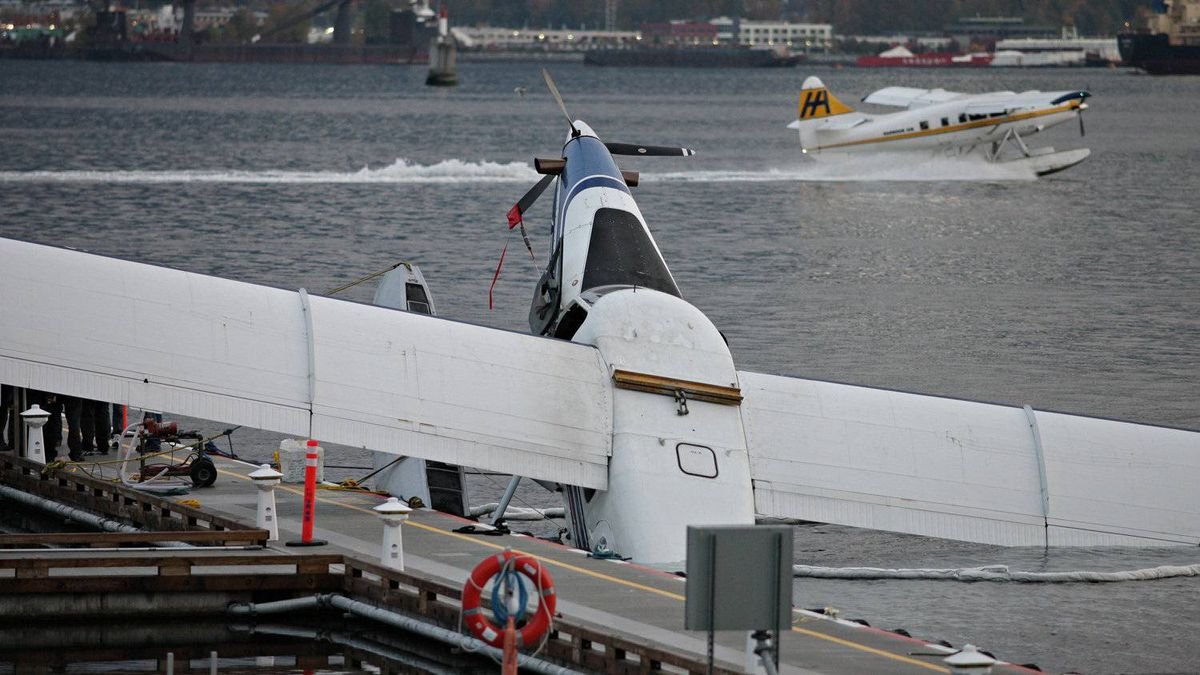 A plane belonging to Harbour Air lies partially submerged at the new dock facilities at the float plane terminal in Vancouver on November 5th, 2011. Questions have been previously raised about the new site's exposure.