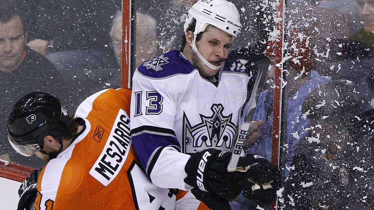 Los Angeles Kings' Kyle Clifford (13) is checked into the glass by Philadelphia Flyers' Andrej Meszaros (41), of Slovakia, during the third period of an NHL hockey game Sunday, Feb. 13, 2011, in Philadelphia. Los Angeles won 1-0. (AP Photo/Matt Slocum)