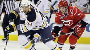 Buffalo Sabres' Andrej Sekera (44), of Slovakia, controls the puck as Carolina Hurricanes' Jerome Samson (71) chases during the first period of an NHL hockey game in Raleigh, N.C., Sunday, April 3, 2011. The Sabres won 2-1 in overtime. (AP Photo/Gerry Broome)