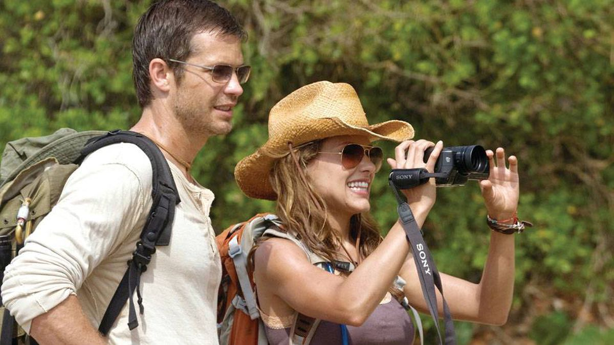 Nick (Timothy Olyphant) and Gina (Kiele Sanchez) observe their surroundings in a paradise that becomes hell on earth as a brutal battle for survival begins in A Perfect Getaway.