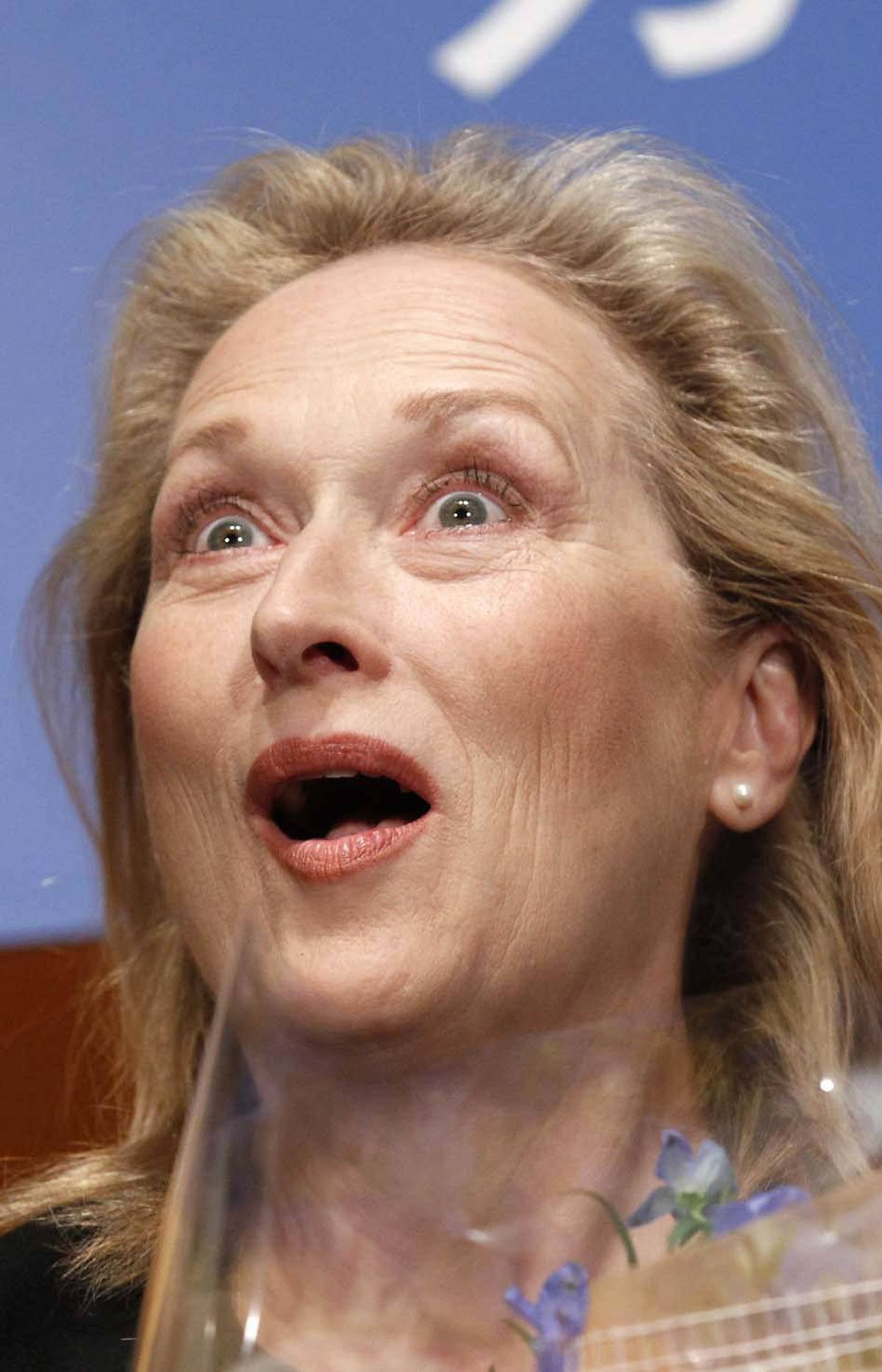 "An emotional Meryl Streep breaks into the Canadian national anthem upon hearing about the robo-call scandal at the premiere of ""The Iron Lady"" in Tokyo on Tuesday."