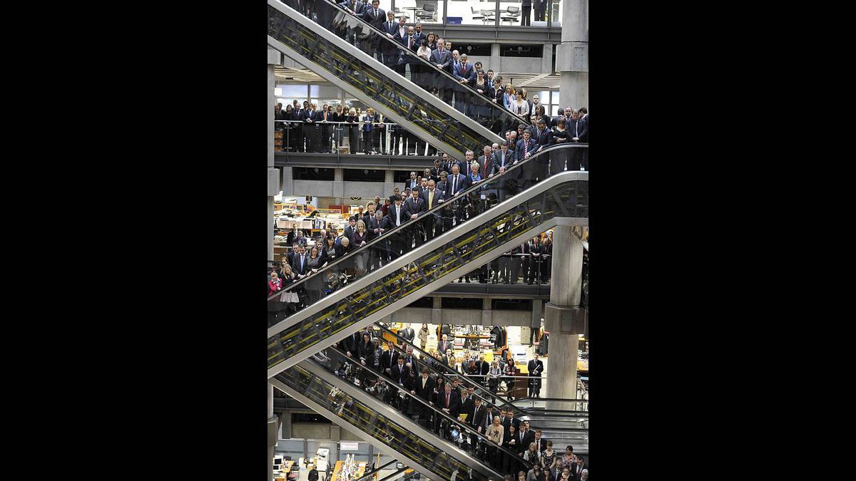 Lloyds of London staff hold their annual Remembrance Day service at the Lloyds Building