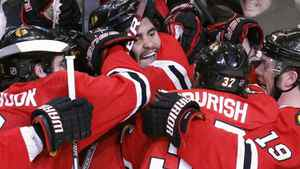 Chicago Blackhawks Dustin Byfuglien (C) celebrates his overtime goal against the San Jose Sharks with team mates during Game 3 of their NHL Western Conference final hockey game in Chicago, May 21, 2010. REUTERS/Jeff Haynes