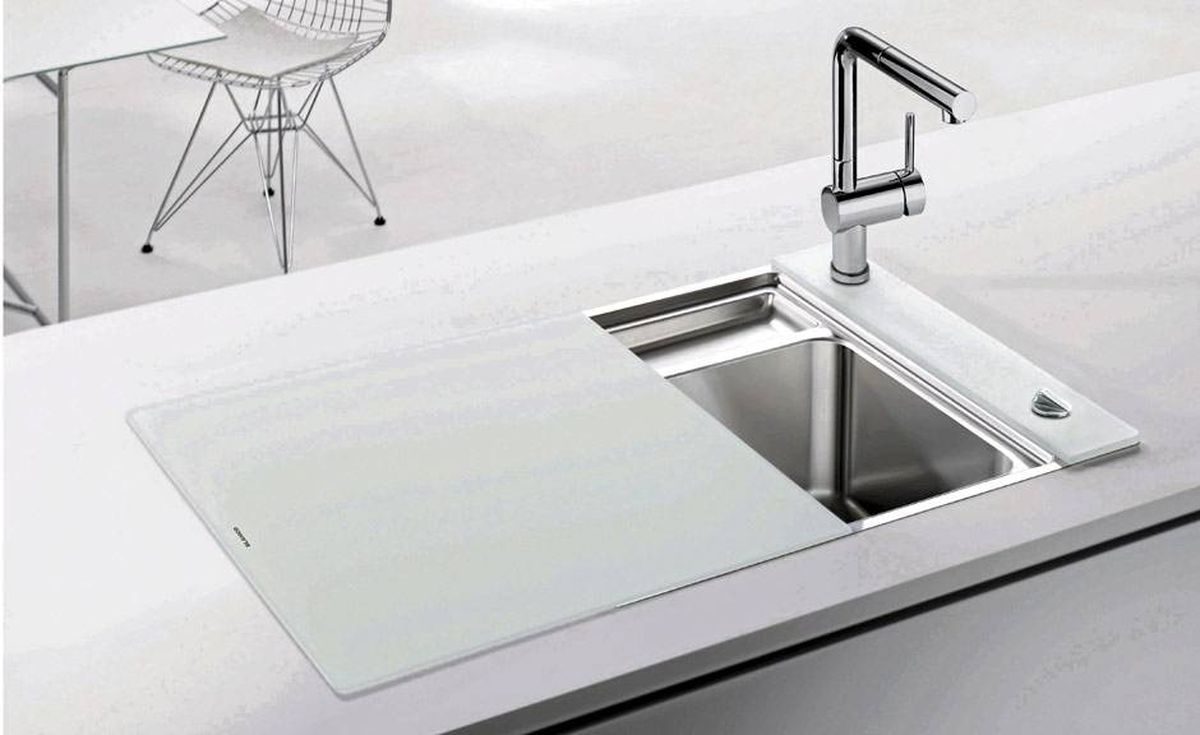 The Crystalline sink by Blanco (www.blancocanada.com) features a glass cover that slides across the basin to create additional counter space.
