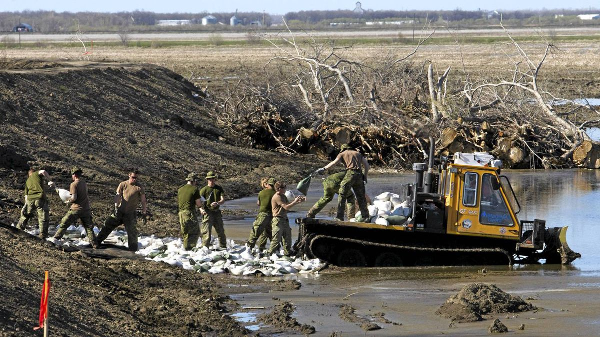 Canadian soldiers re-enforce a soft spot in the dike along the Assiniboine River Sunday, May 15, 2011 in Poplar Point, Manitoba. Even with all the high water this year, Manitoba's system of dikes, dams and diversion canals has protected the vast majority of buildings. Only 100 homes across the province have been flooded so far, according to government statistics, and only 10 have had flooding above the basement level.