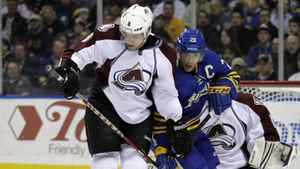 Buffalo Sabres' Jason Pominville (29) battles for the puck with Colorado Avalanche's Jan Hejda (8), of the Czech Republic, during the first period of an NHL hockey game in Buffalo, N.Y., Wednesday, March 14, 2012.