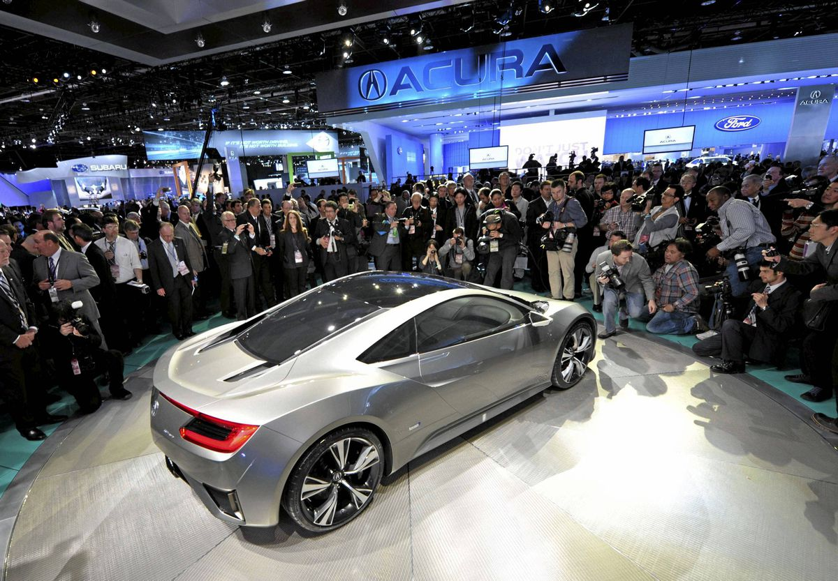The Acura NSX hybrid concept car is shown to members of the media Monday at North American International Auto Show in Detroit.