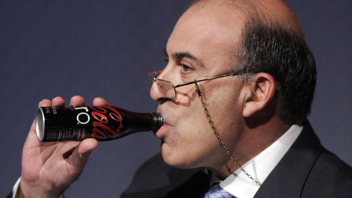 Coca-Cola CEO Muhtar Kent takes a drink of a Coca-Cola Zero during an address to investors at a meeting Monday, Nov. 16, 2009, in Atlanta.