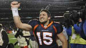 Denver Broncos quarterback Tim Tebow (15) celebrates after beating the Pittsburgh Steelers 29-23 in overtime of an NFL wild card playoff football game Sunday, Jan. 8, 2012, in Denver.