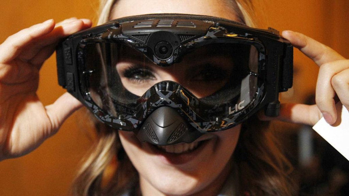 Christina McDonald Groff demonstrates a pair of snow goggles by Liquid Image with an HD video camera and high resolution still camera integrated into them at a preview of the Consumer Electronics Show (CES) in Las Vegas January 4, 2011. The goggles will be available at the end of the month for around $400.