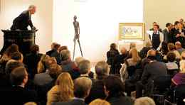 Auctioneer Henry Wyndam sells the sculpture 'Walking Man I' or 'L'Homme qui marche I', by Alberto Giacometti, at Sotheby's auction rooms in London, Wednesday Feb. 3, 2010. The life-size bronze sculpture of a man by Alberto Giacometti was sold at the London auction for 65 million pounds (US$104 million). Sotheby's says the sale set a world record for the most expensive work of art ever sold at auction. The auction house said Wednesday it took just eight minutes for bidders to reach the hammer price for the item. (AP Photo / Anthony Devlin, pa) **UNITED KINGDOM OUT: NO SALES: NO ARCHIVE:**