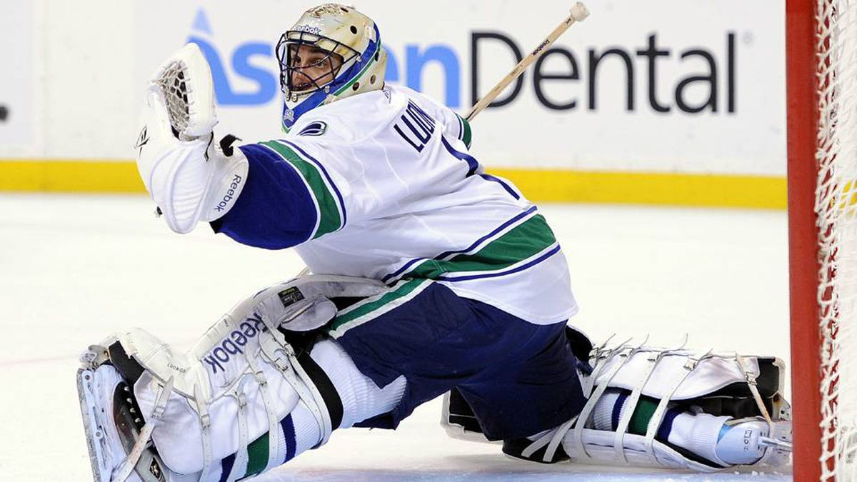 Roberto Luongo of the Vancouver Canucks makes a save against the Boston Bruins during Game 4.