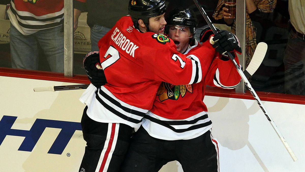 Brent Seabrook #7 of the Chicago Blackhawks hugs teammate Patrick Kane #88 after Kane scored his second goal of the game against the St. Louis Blues at the United Center on November 30, 2010 in Chicago, Illinois. The Blackhawks defeated the Blues 7-5.