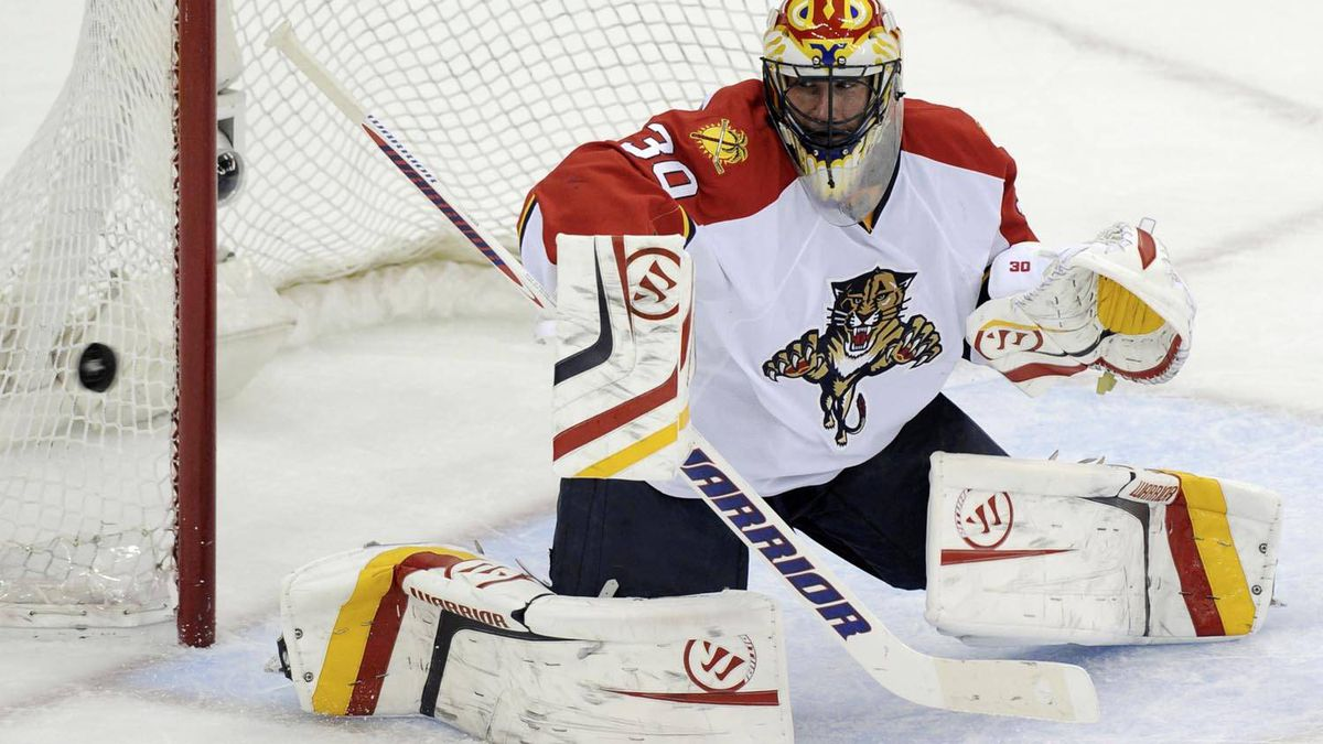 Florida Panthers goalie Scott Clemmensen makes a save against the New Jersey Devils during the second period of Game 6 of their NHL Eastern Conference quarter final playoff hockey game in Newark, April 24, 2012. REUTERS/Ray Stubblebine