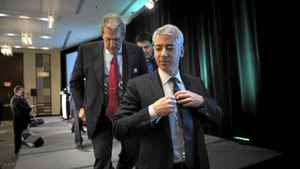 Bill Ackman, foreground, CEO of Pershing Square Capital Management, and Hunter Harrison, former CEO of Canadian National Railway, leave the stage after a town hall meeting Feb. 6, 2012, in Toronto.