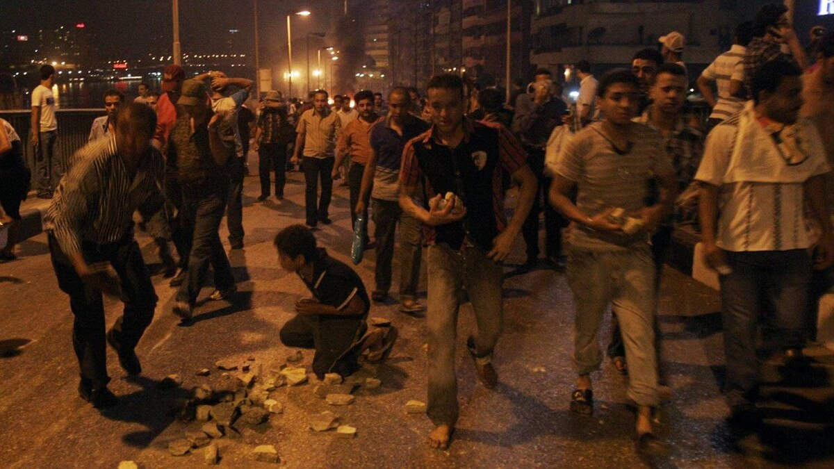 Protesters gather rocks during clashes with Egyptian security forces at a protest of a recent attack on a church in Cairo Egypt, Sunday, Oct. 9, 2011.