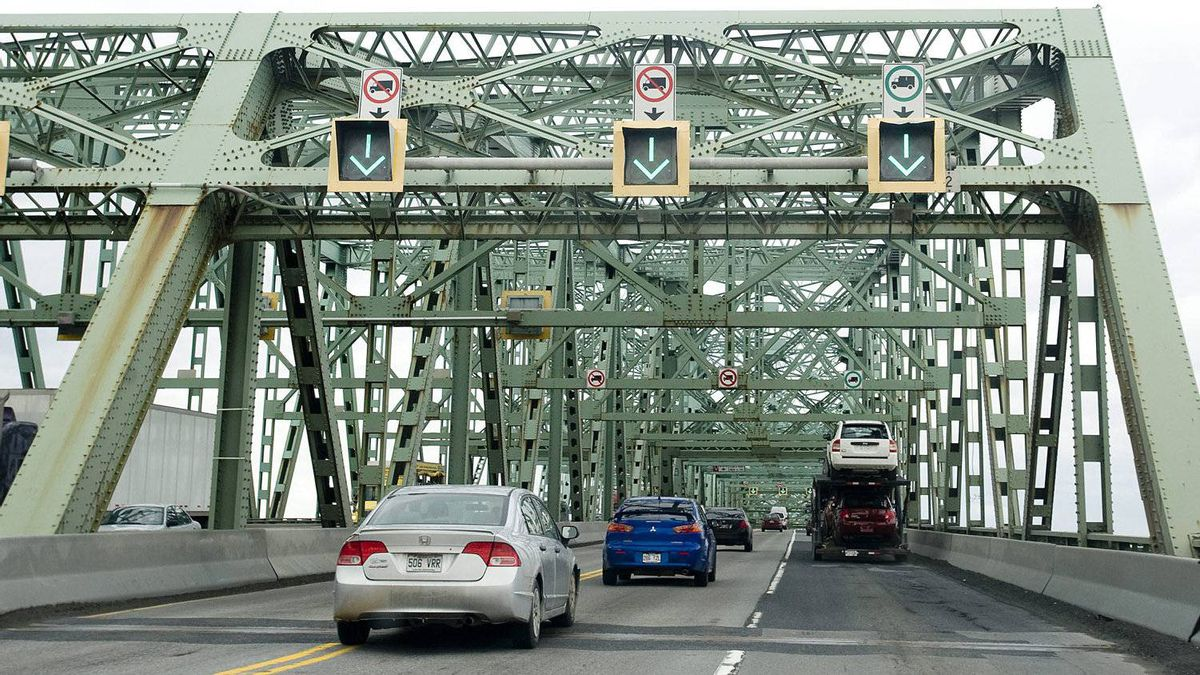 Motorists cross the Champlain Bridge in Montreal, Friday, March 18, 2011. Now Canada's busiest bridge with up to 60 million vehicles crossing per year since opening to traffic in 1961, the bridge is in need of major repair and has become a safety concern to users.