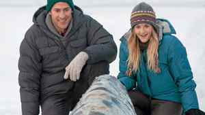 """John Krasinski, left, and Drew Barrymore commune with a whale in a scene from """"Big Miracle."""""""