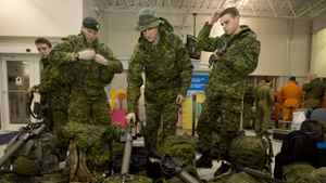 Canadian military personnel at CFP Trenton prepare to leave on a Disaster Assistance Response Team ( DART) humanitarian mission to Haiti. Darren Calabrese/The Canadian Press