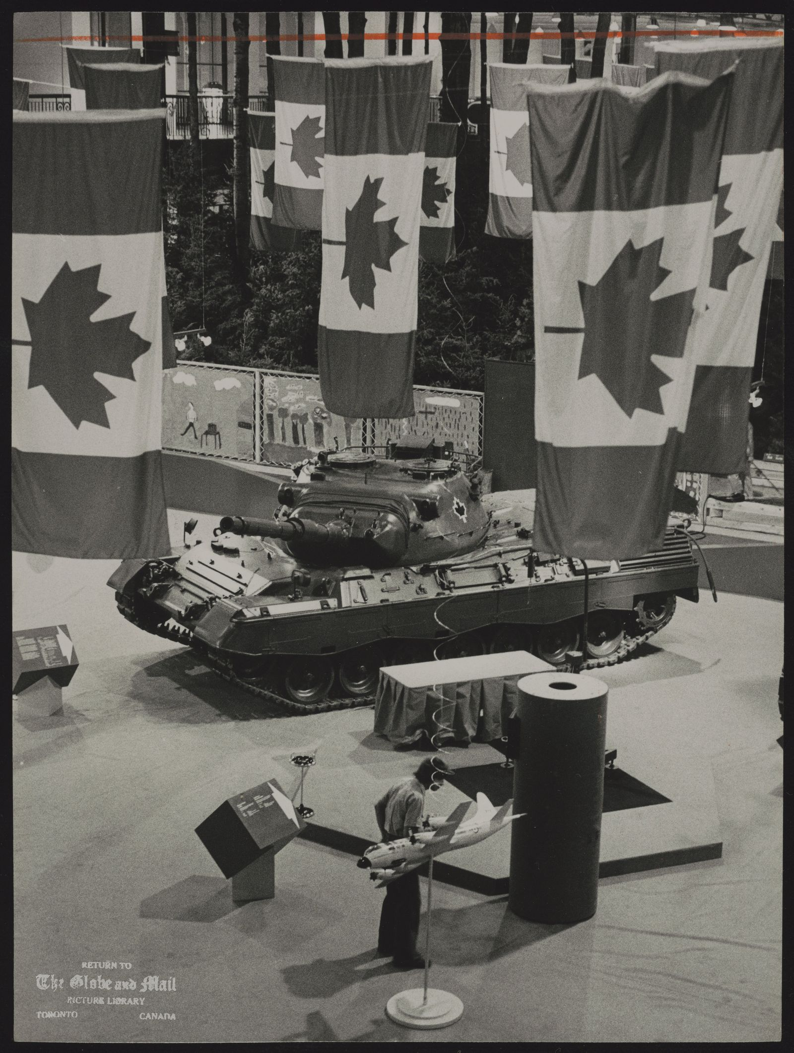 The notes transcribed from the back of this photograph are as follows: CANADIAN NATIONAL EXHIBITION Misc. This Leopard C1 tank, made in West Germany, will be on display in Our Canada pavillion when CNE opens today.