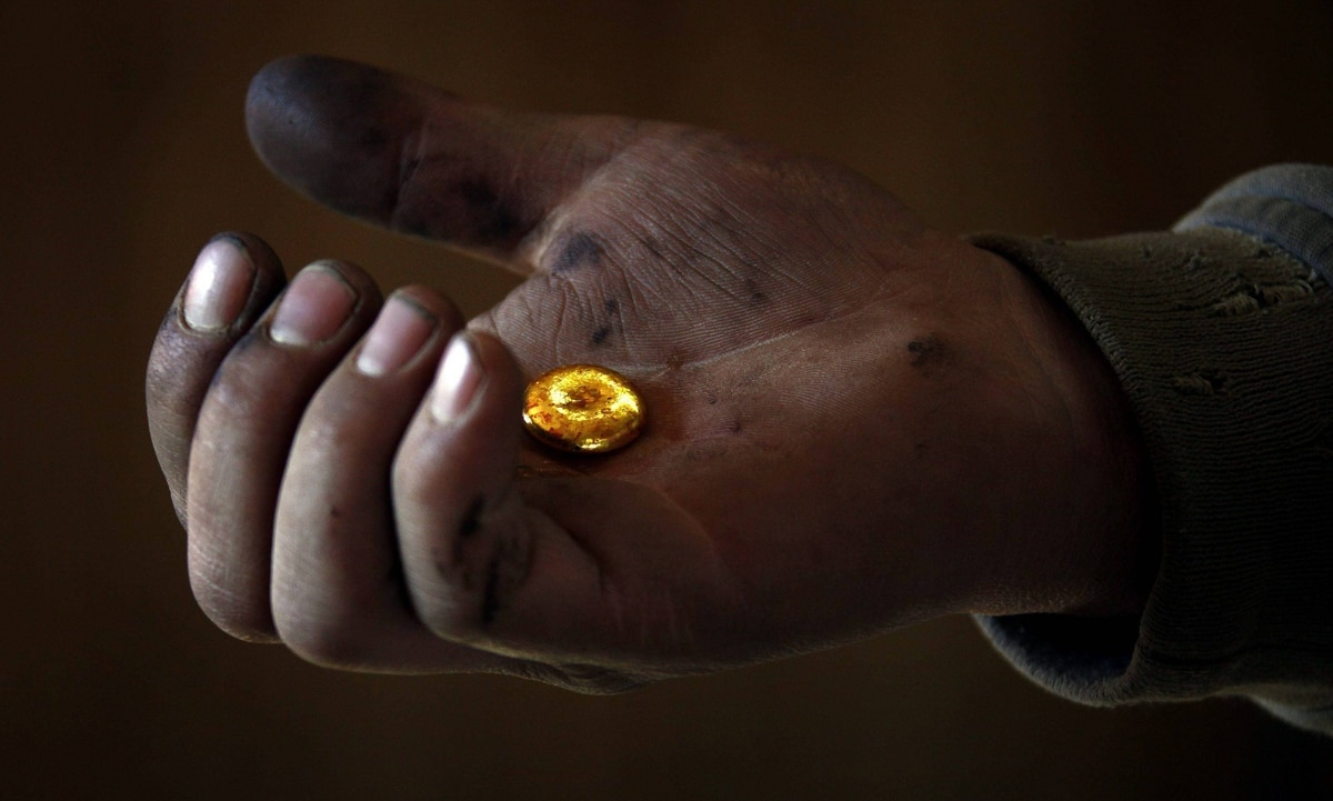 A small-scale miner holds his gold that was melted together at a processing plant located around 100km north of the Mongolian capital city Ulan Bator.