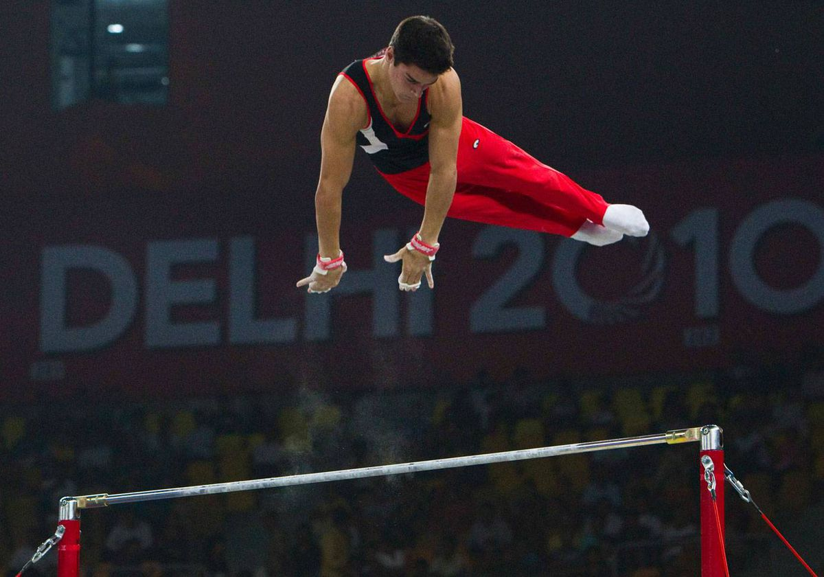 Canada's Anderson Loran competes on his way to a silver medal in the men's gymnastics horizontal bar finals at the Commonwealth Games in New Delhi October 8, 2010.