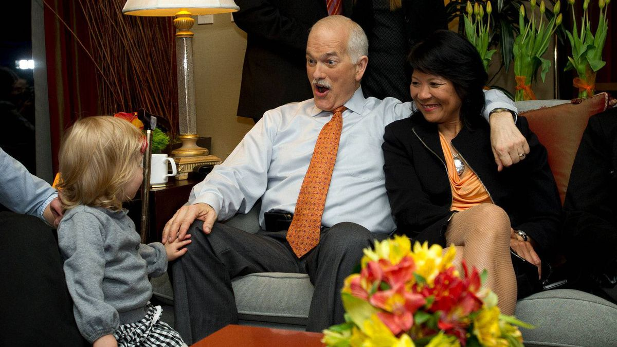 New Democratic Party (NDP) leader Jack Layton and Olivia Chow react to grand-daughter Beatrice while watching election results come in from a hotel suite in Toronto, Ont. May 2, 2011.