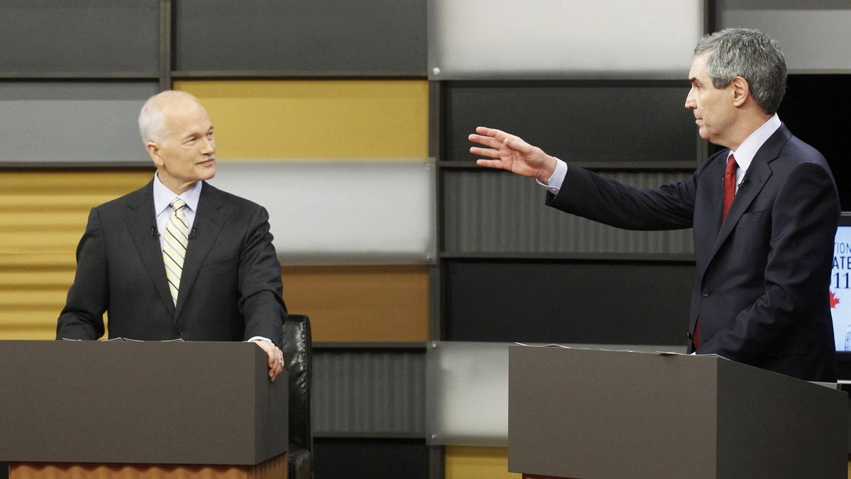 New Democratic Party leader Jack Layton (L) debates Liberal leader Michael Ignatieff (R) during a televised English language debate in Ottawa, April 12, 2011. Canadians will head to the polls in a federal election on May 2.