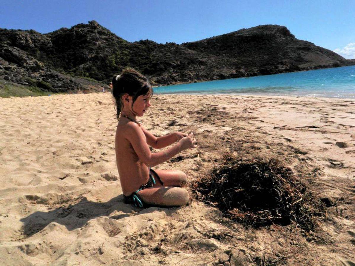 Cheyenne Palma-Tinghir plays in the sand on the nearly empty Saline Beach.