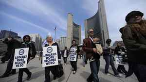 Toronto Public Library workers march outside Toronto City Hall on March 19, 2012, after talks with the city stalled on the weekend.