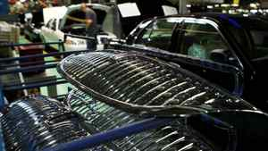Grilles destined for the front of Crown Victoria models are stacked near the line.