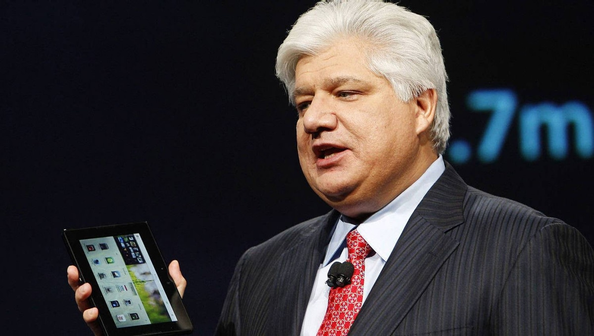 Mike Lazaridis, president and co-chief executive officer of Research In Motion, with a PlayBook tablet.