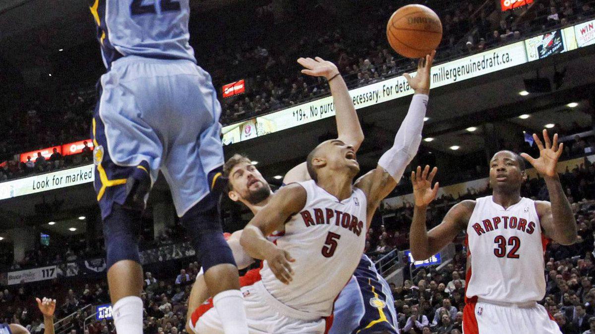 Toronto Raptors' guard Jerryd Bayless goes to the basket against Memphis Grizzlies' Marc Gasol and Rudy Gay during the Grizzlies' 100-98 win in Toronto on Jan. 24, 2011.