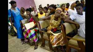 A room full of pregnant women wait to be assessed by hospital staff and trainees in the Princess Christian Maternity Hospital in Freetown.