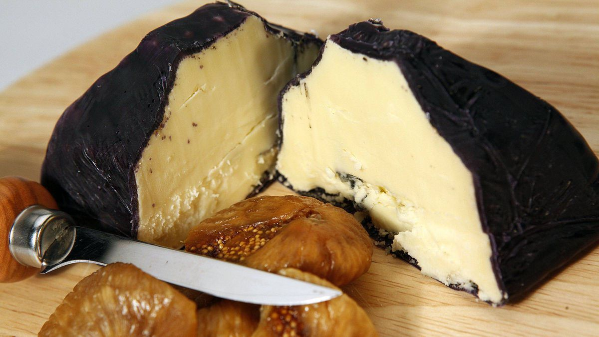 Devil's Rock blue cheese, a blue cheese covered with a black wax and photographed with figs in the studio at The Globe and Mail in Toronto, Ontario, Canada.