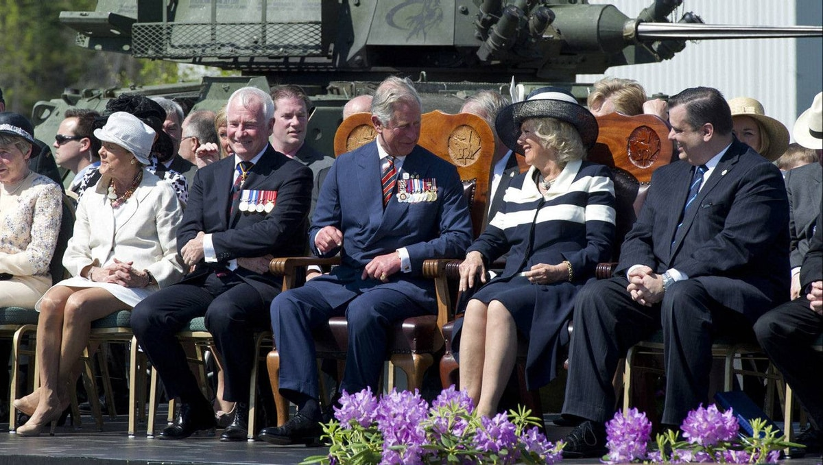 Prince Charles chats with his wife Camilla and Heritage Minister James Moore while sitting next to Governor General David Johnston and his wife Sharon during their official welcome ceremony at CFB Gagetown in Oromocto, N.B., on Monday, May 21, 2012. The royal couple are on a three-day visit to Canada to mark the Queen's Diamond Jubilee.