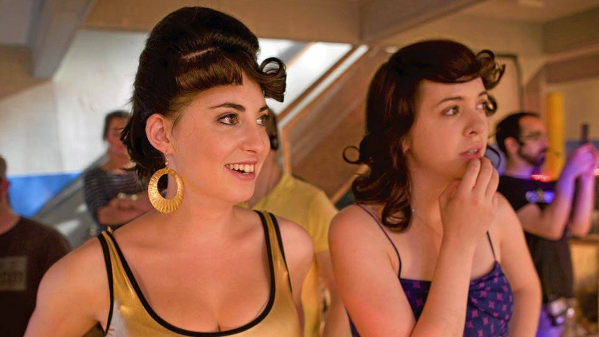 From left, Roller Town actors Evany Rosen (playing Beth) and Kayla Lorette (playing Julia) watch filming at the Olympic Community Centre in Halifax, September 25, 2010.