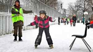 Fiona Bathelt, 7, races around the busy ice rink at the Dufferin Grove