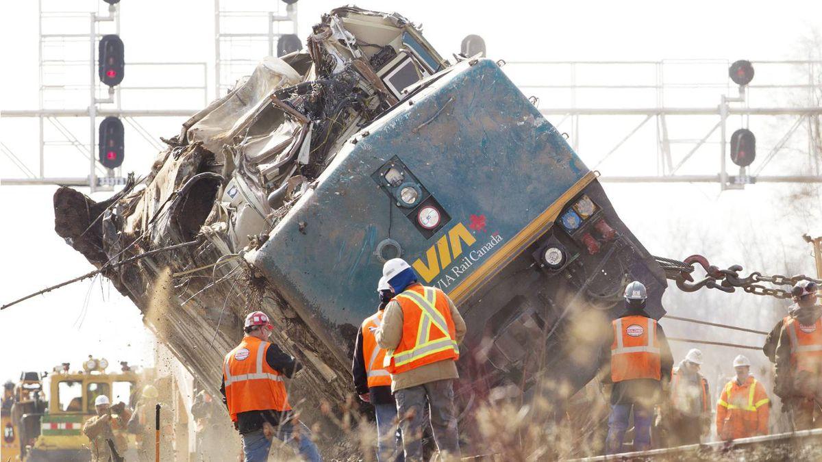 Crews right a locomotive Tuesday afternoon in Burlington, Ontario where a VIA rain derailed killing three Sunday.
