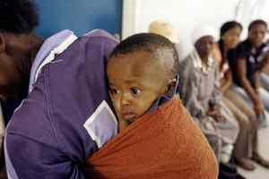 A mother and child await treatment at the Empilisweni Clinic in Worcester, South Africa, on Feb. 4, 2008.