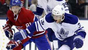 Toronto Maple Leafs forward Kris Versteeg goes after a loose puck against Montreal Canadiens forward Lars Eller (L) during the first period of their NHL hockey game in Toronto December 11, 2010. The Leafs won 3-1. REUTERS/Mike Cassese