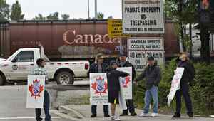 Picketers stand at the entrance to the CP Rail yards in Coquitlam, British Columbia May 23, 2012.