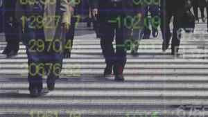 People are reflected on a stock quotation board outside a brokerage in Tokyo April 24, 2012.
