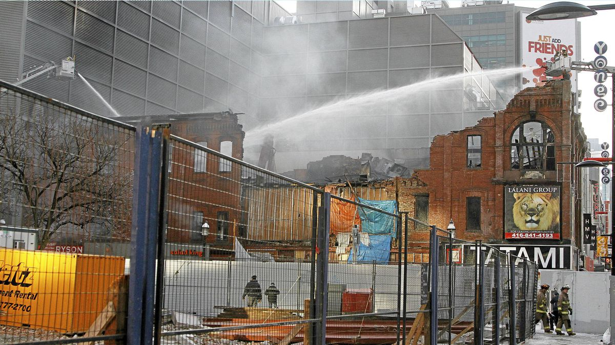 Firefighters work to extinguish the last remaining of fire at the the old Salad King, an heritage building located on Yonge and Gould Streets that resulted destroyed by a six-alarm blaze.