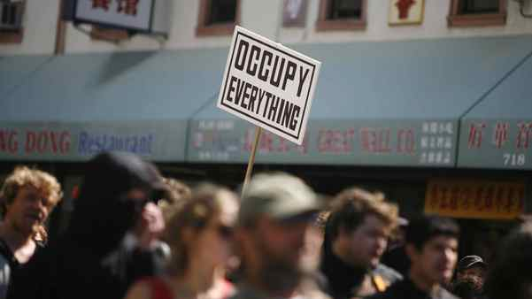 Occupy demonstrators rally in the streets as part of a nationwide May Day protest in Oakland, Calif.