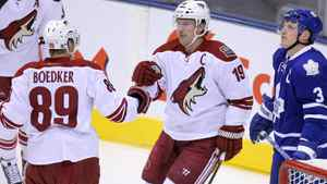 Phoenix Coyotes right wing Shane Doan (19) celebrates his goal with right wing Mikkel Boedker (89) against the Toronto Maple Leafs at the Air Canada Centre.