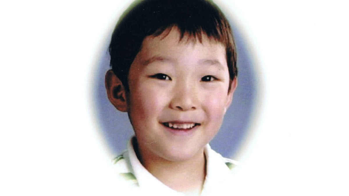 A picture of Christian Lee used on the cover of a memory book. Christian, his mother and sibling were killed by his father Peter Lee in 2007 .